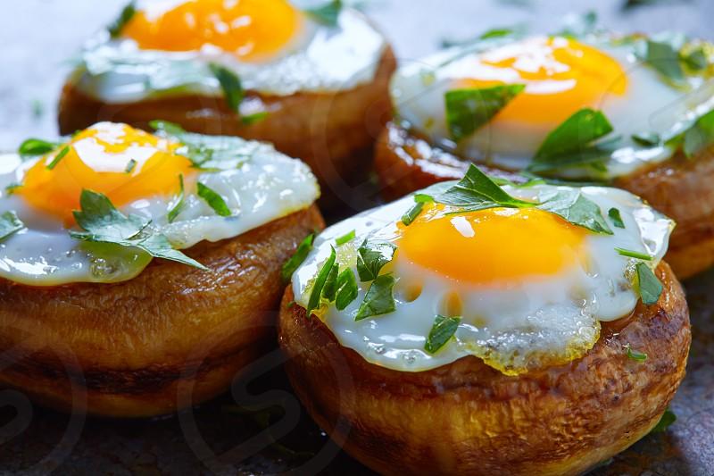 Tapas mushrooms with quail eggs from Spain pinchos pintxos photo
