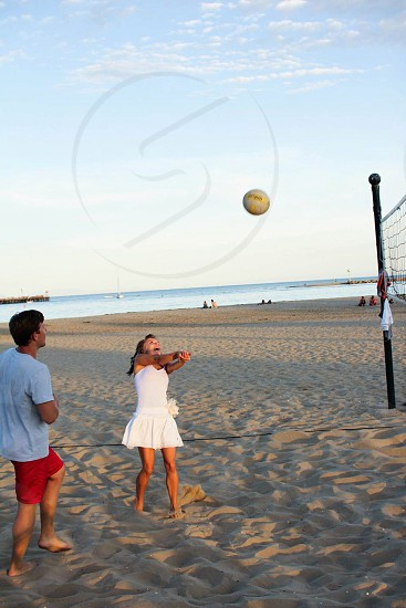 two people playing beach volleyball photo