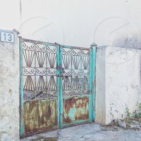blue metal gate closed photo