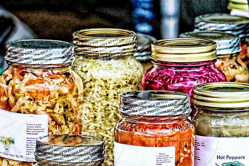 Detail of farm preserves in mason jars at a farmer's market photo