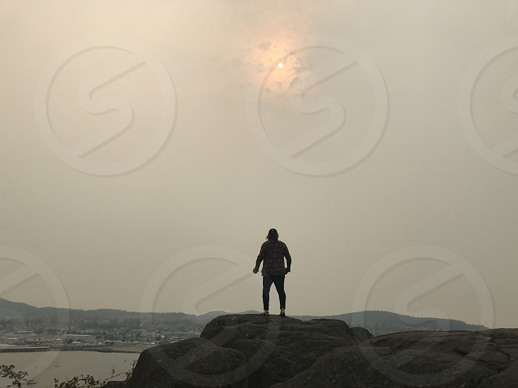 A women starring out at the smoke filled skies from wild fires. photo