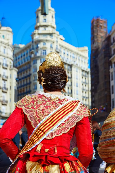 Unknown falleras dress from Valencia Fallas fest in a row at Spain photo