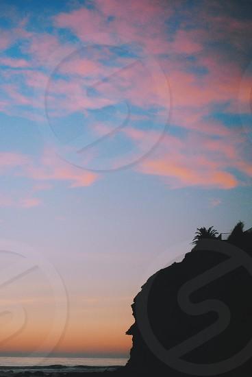 mountain silhouette in beach photo