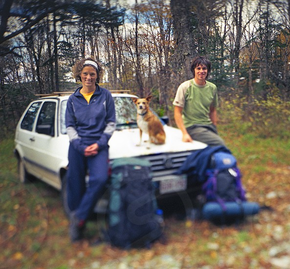 camping dog young couple woods backpacking photo