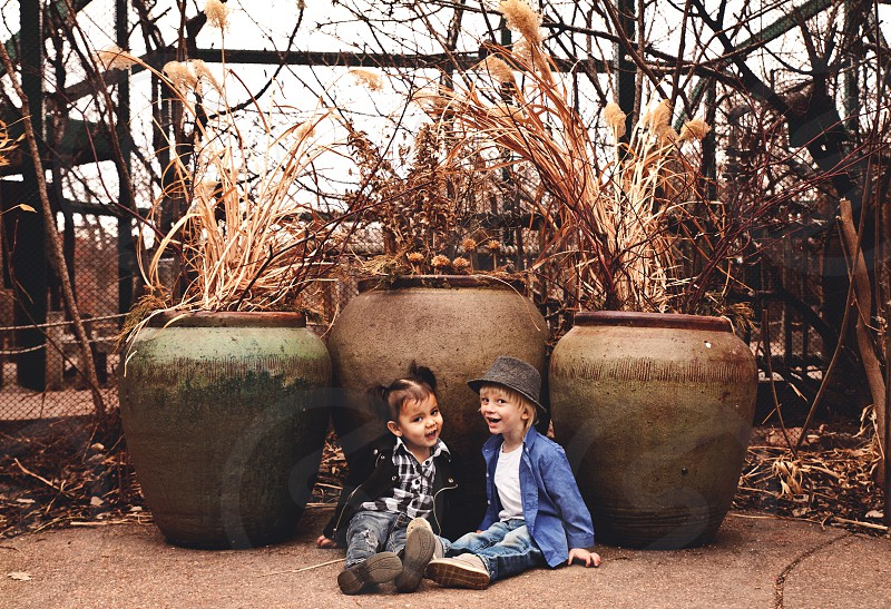 children best friends boy and girl toddlers zoo smiling cheerful sitting denver fedora leather jacket babies sweet companionship photo