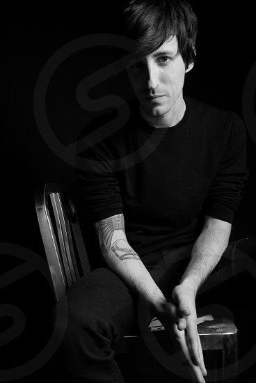 man sitting on chair portrait photography photo