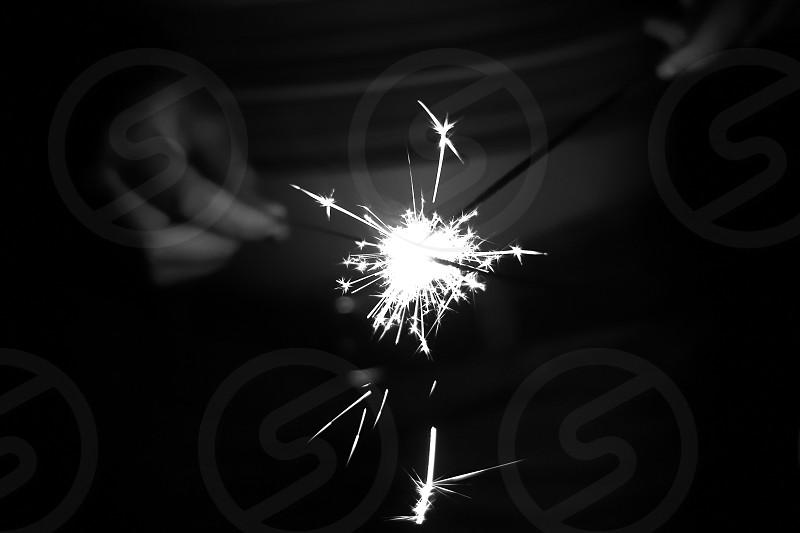 person lighting a firecracker photo