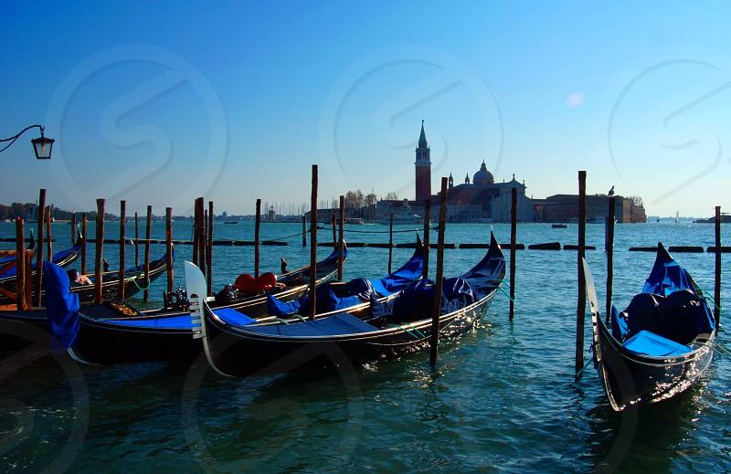view of venice with gondolas photo