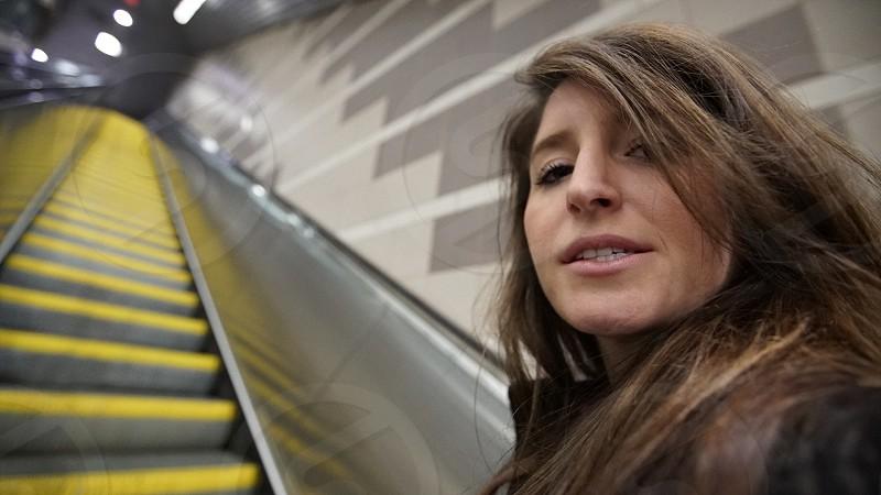 Girl subway going up photo
