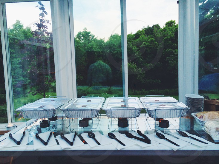 4 silver dish tray on table near glass window photo