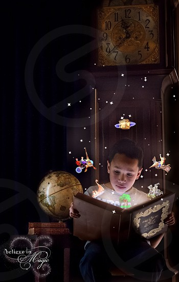 Young boy reading magical story fairytalereading photo