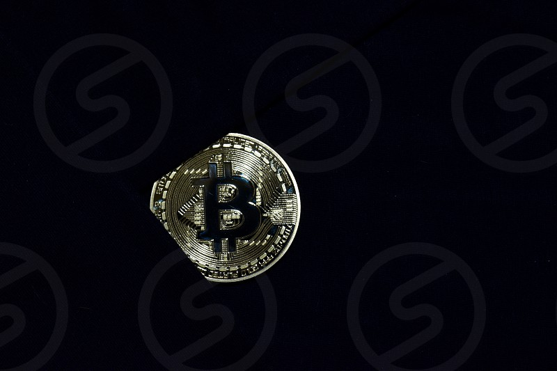 Bitcoin gold on black fabric background. for savings bitcoin to secure. Business concept  photo