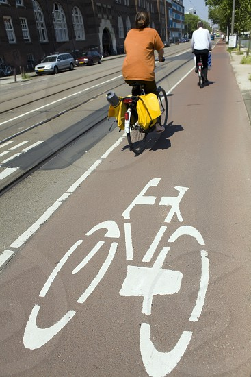 bike; bicycle; netherlands; bicycling; person; people; urban; fast; traffic; road; city; cityscape; transportation; sign; outdoors; Dutch; Holland; bike riding; speed; biker; citizens; speedily; bikers; quick; speeding; biking; quicken; cycling; quicker; cyclist; cyclists; outside; metropolitan; metropolitan area; street; signs; way; outdoor; amsterdam; road sign; traffic sign; traffic signs; pedal photo