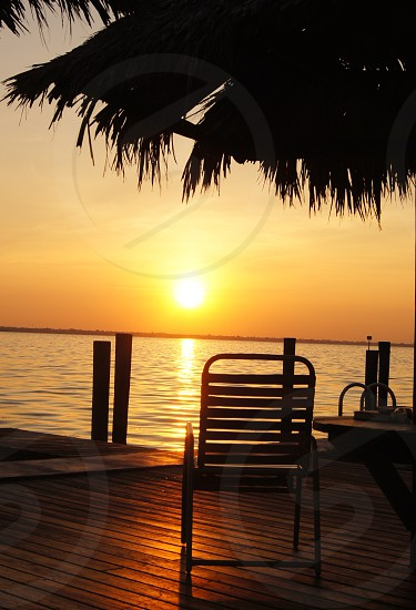 chair on dock on a sunset view photography photo