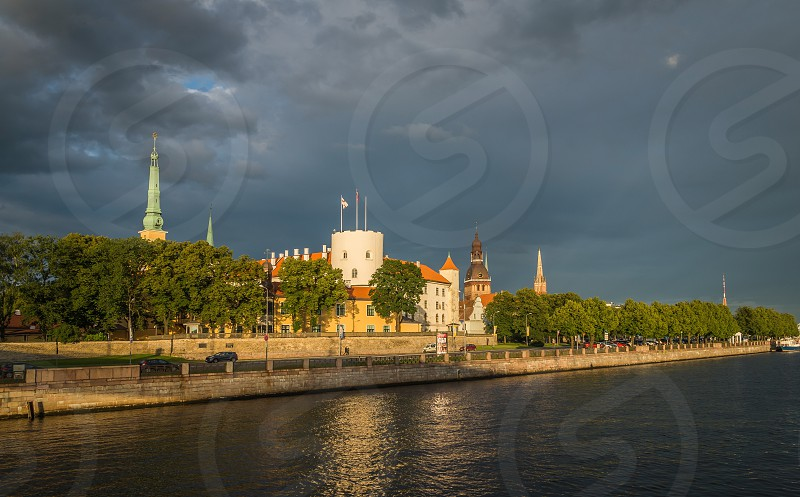 Fantastic view of the Riga Castle from the riverside in a summer evening photo