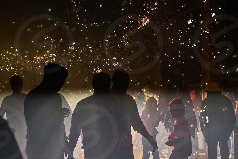 Fire; firecrackers ; firecrackers; light; dark; contrast; shadows;  photo