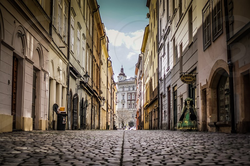 The clean, old cobblestone streets of Prague by Robert Ruggiero. Photo  stock - Snapwire