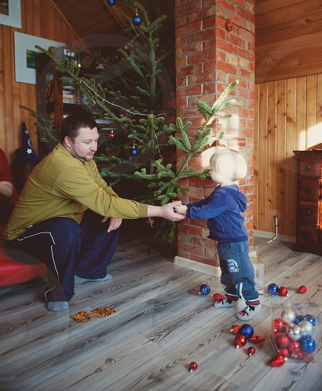 Dad and son making the Christmas tree photo
