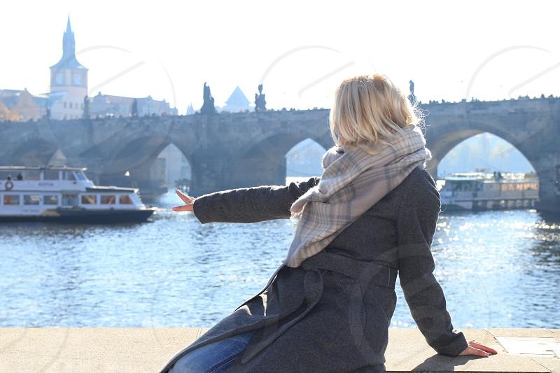 Woman blonde river bridge photo
