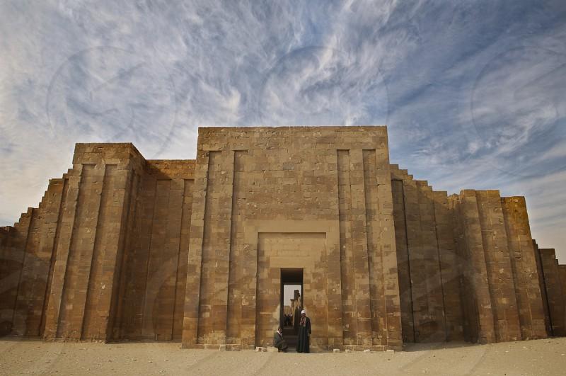 The entrance to the Giza plateau near Cairo Egypt. ancient ruins sky clouds drama dramatic archeology sand portal photo