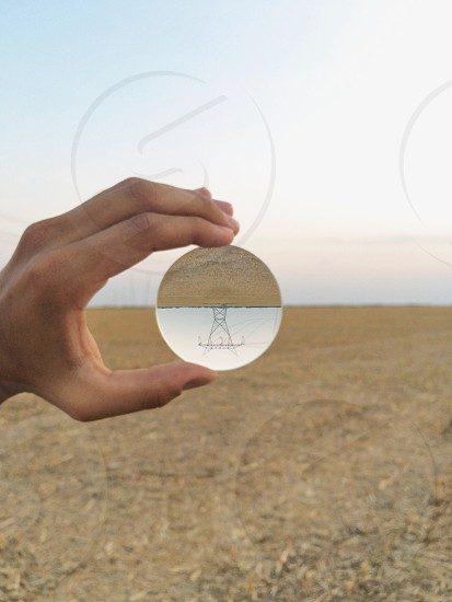 clear round glass orb on hand photo