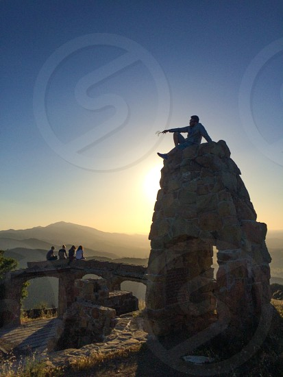 view of man on a stone cliff photo