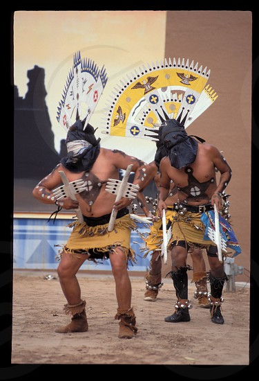 A group of traditional Apache crown dancers during the Red Rock Inter-tribal Indian Festival near Gallup New Mexico photo