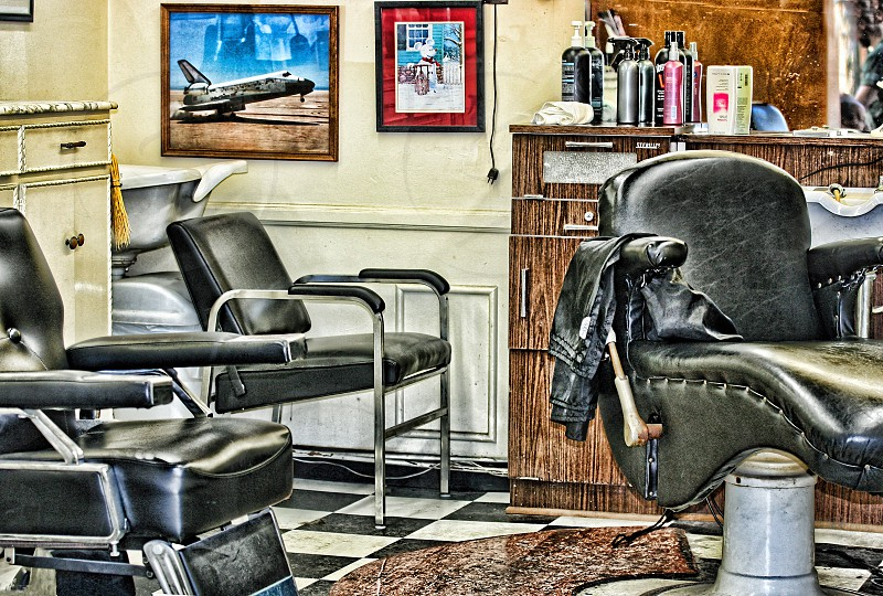 Chairs inside an old-fashioned barber shop photo