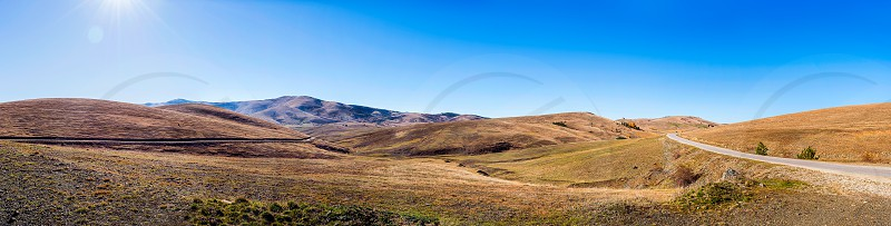 Landscape panorama of peaceful and pastoral meadows and hills - Mount Zlatibor Serbia photo