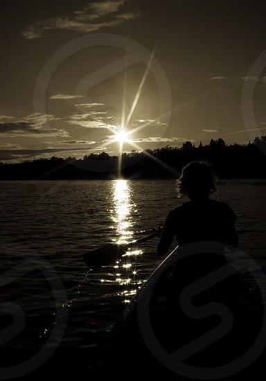 paddle canoe sunset water lake sun beam maine photo