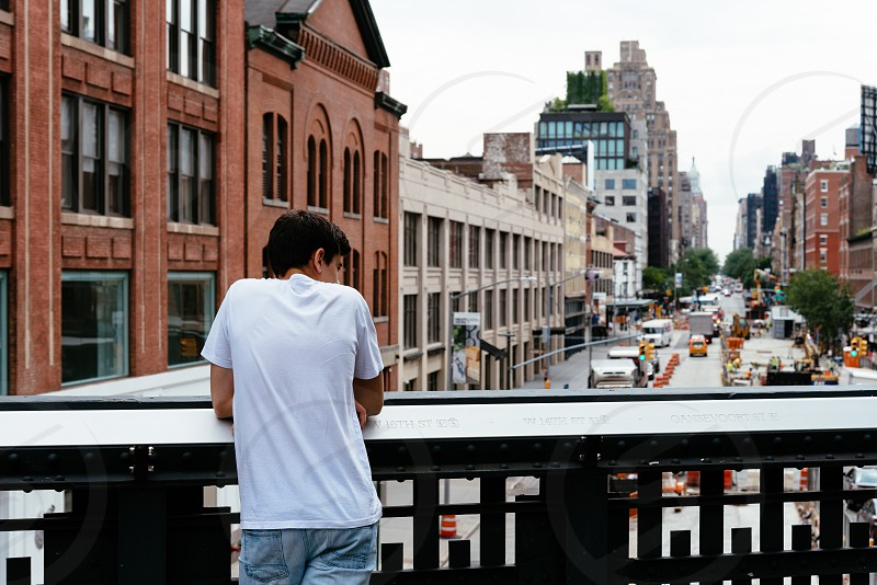 Young man looking at Meatpacking district in New York from High Line photo