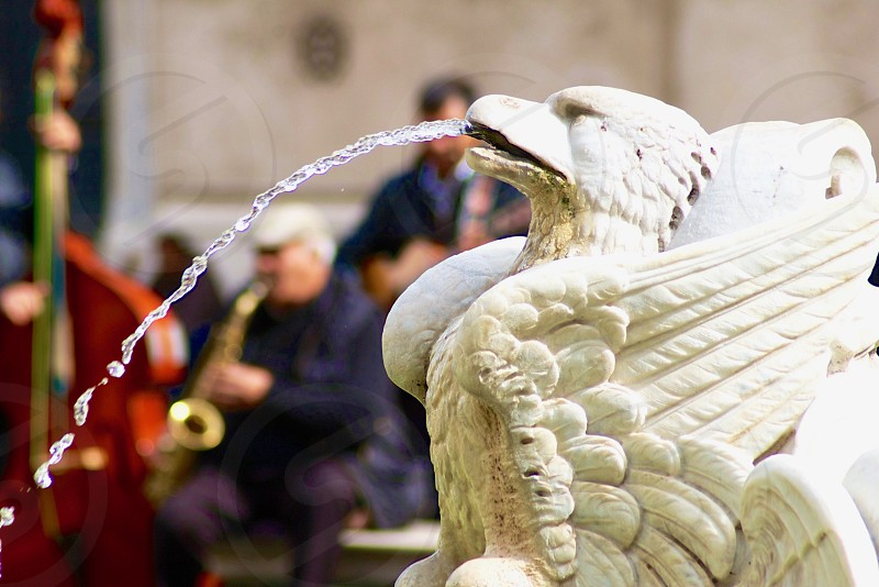 Musicians viewed through a fountain Piazza Navona Rome Italy photo