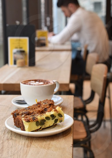 Coffee and cake on cafe counter. photo