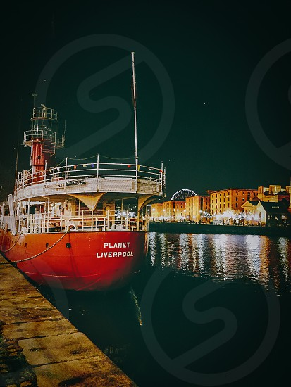 planet liver pool ship on the dock port during night time photo