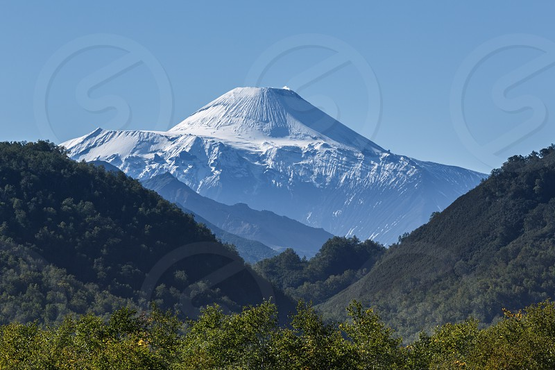 Nature of Kamchatka Peninsula: beautiful summer landscape - view on active Avachinsky Volcano on a sunny day. Russia Far East. photo
