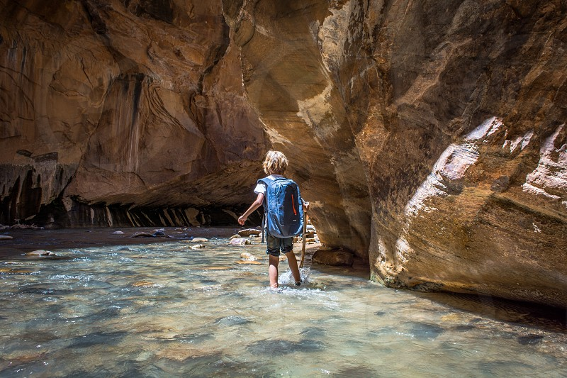 Zion National Park Utah Nature Narrows water trail adventure hike boy child  youth young backpack stick virgin river  photo