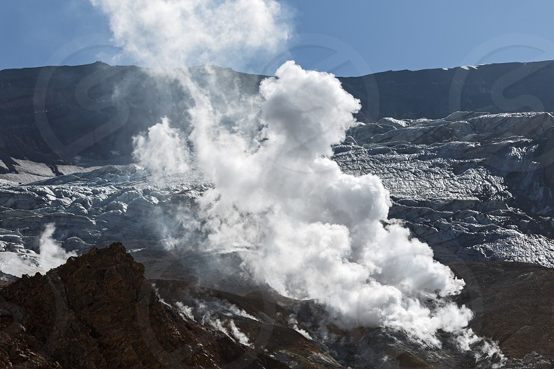 Volcanic landscape of Kamchatka: view of the smoking fumarole in crater of active Mutnovsky Volcano. Kamchatka Peninsula. Russian Far East Eurasia. photo