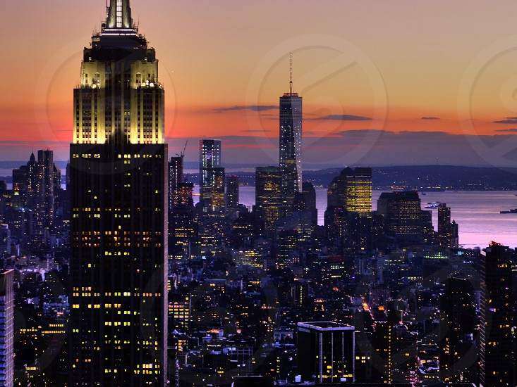 lighted empire state building at sunset photo