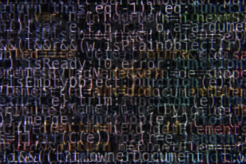 Dark Program Source Code Segments on Computer Screen Abstract Background photo