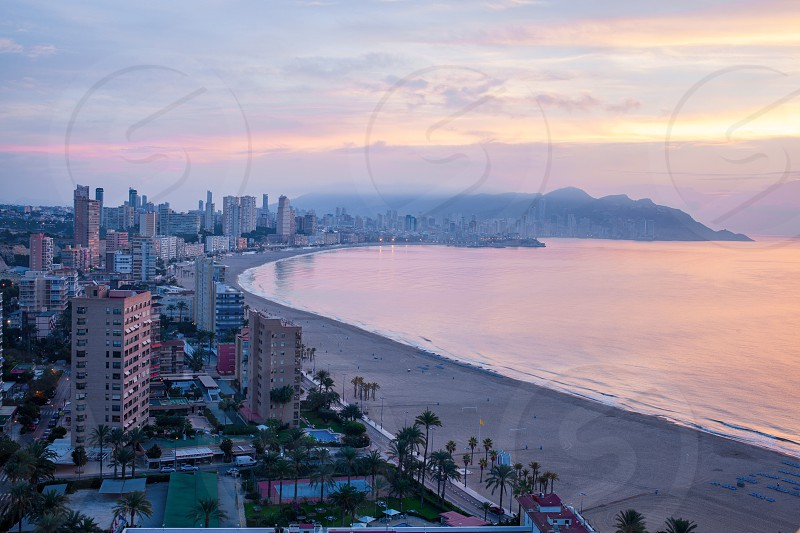 A panoramic view of the tourist hub Benidorm at dawn photo