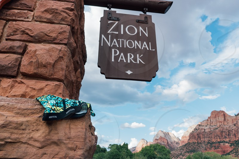 zion national park sign under grey cloudy sky photo