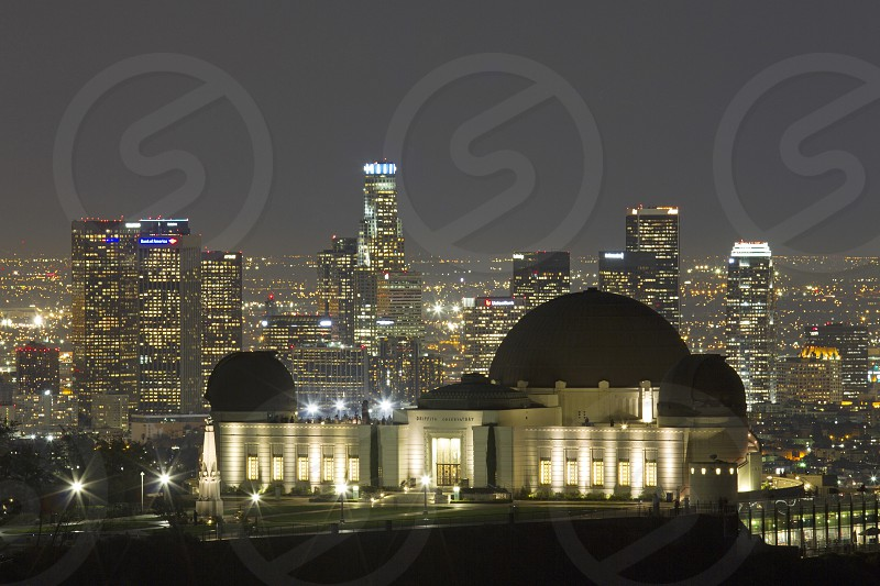 Long exposure of Griffith Observatory and the downtown Los Angeles skyline at night. photo
