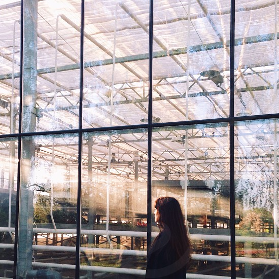 woman walking by a glass window factory photo