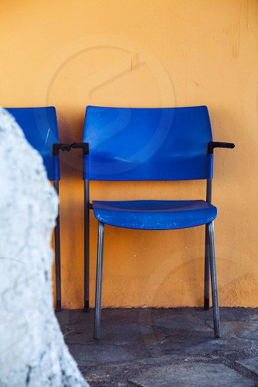 Minimalistic lifestyle  chairs seats seat contrasts blue yellowwall background  photo