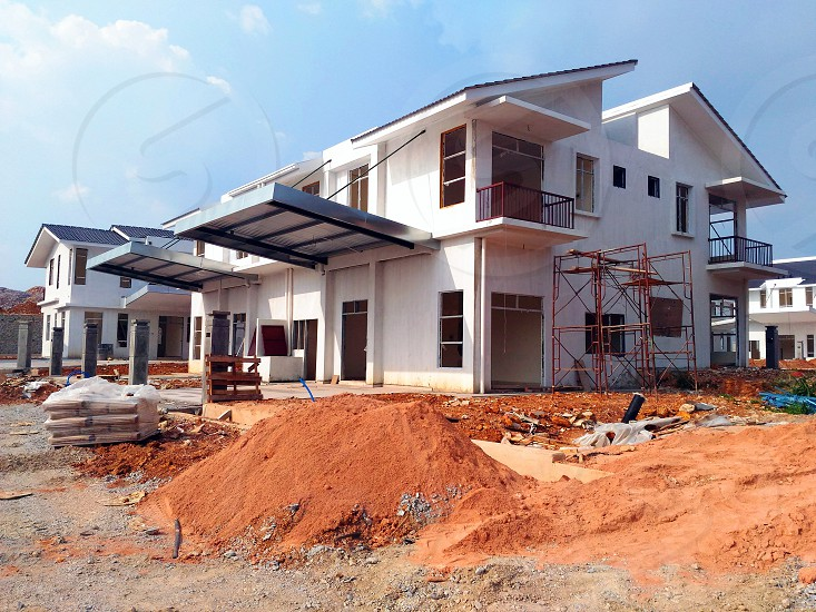 white concrete under construction house during daytime photo