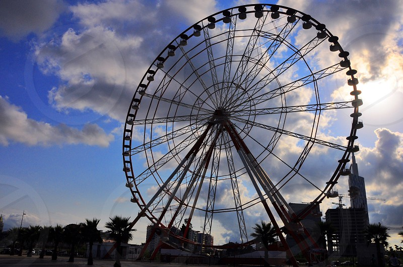 ferris wheel with clouds photo