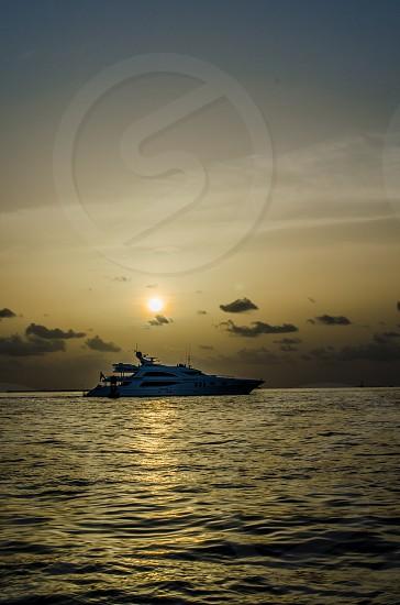 Yacht off the coast of Key West at sunset. photo