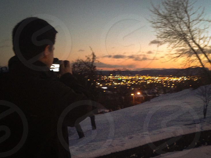 My Friend taking a picture of Thunder Bay from Hillcrest Park. photo