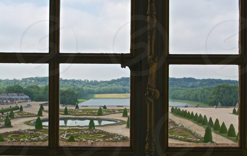 brass framed glass window photo