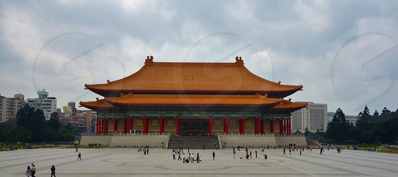 chinese building with brown roof tiles photo